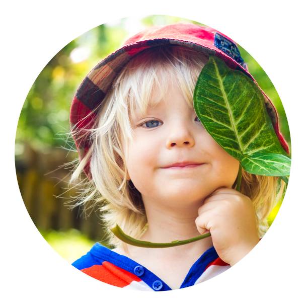a child holding a leaves